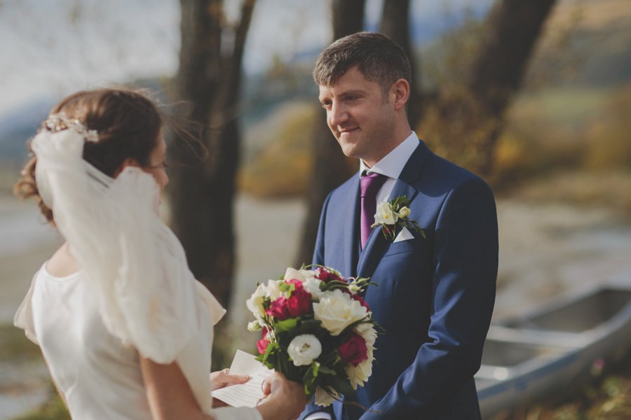 Bel and Liam exchange wedding vows by Lake Wakatipu