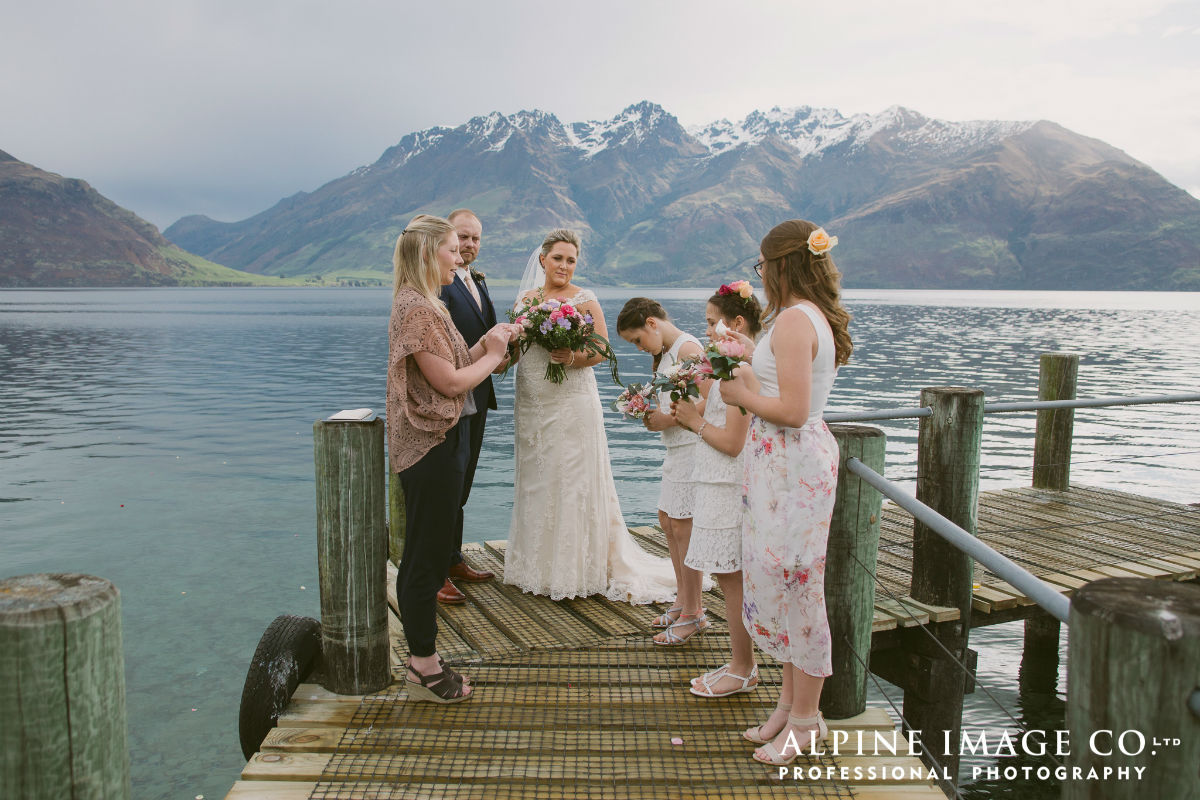 Guiding the kids through a ring warming/blessing at this Lake Wakatipu wedding, Queenstown